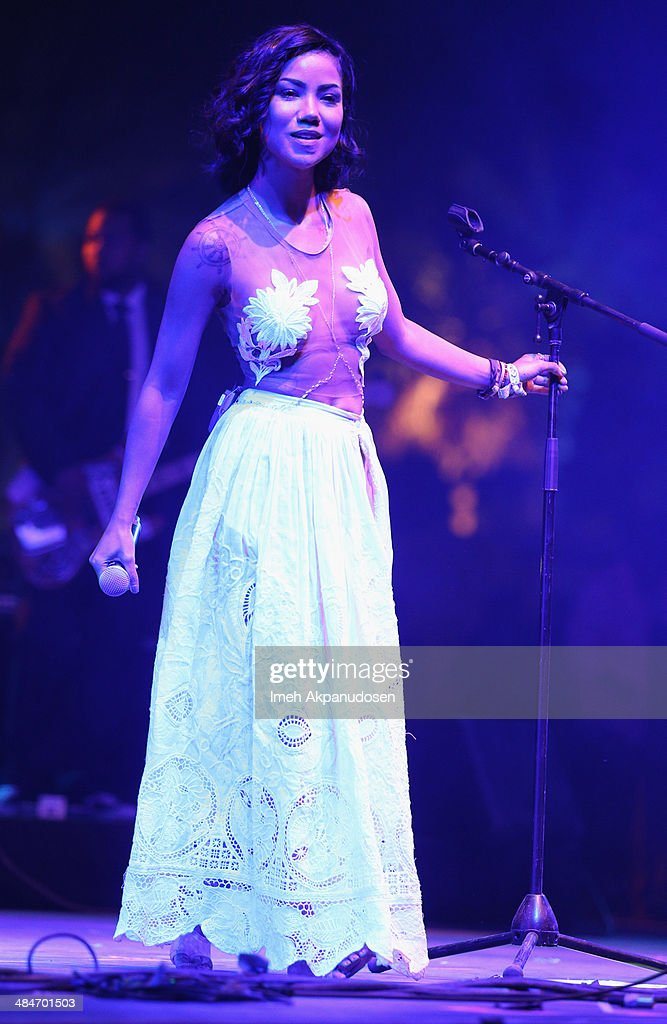 Singer Jhené Aiko performs onstage during day 3 of the 2014 Coachella Valley Music Arts Festival at the Empire Polo Club on April 13 2014 in Indio...