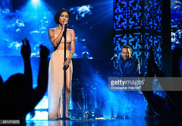 Singer Jhene Aiko and singer/songwriter John Legend perform onstage during the BET AWARDS '14 at Nokia Theatre LA LIVE on June 29 2014 in Los Angeles...
