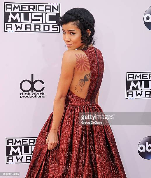 Singer Jhene Aiko arrives at the 2014 American Music Awards at Nokia Theatre LA Live on November 23 2014 in Los Angeles California