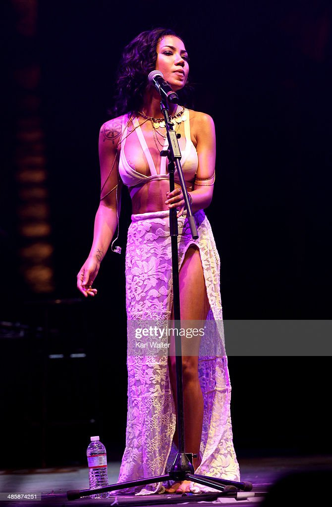Singer Jhene Aiko performs onstage during day 3 of the 2014 Coachella Valley Music & Arts Festival at the Empire Polo Club on April 20, 2014 in Indio, California.