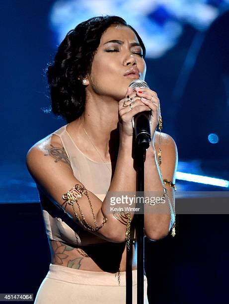 Singer Jhene Aiko performs onstage during the BET AWARDS '14 at Nokia Theatre LA LIVE on June 29 2014 in Los Angeles California