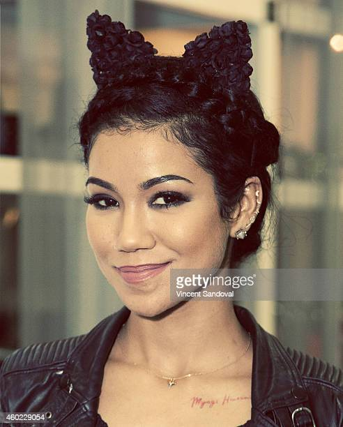 Singer Jhene Aiko unveils clothing collaboration with Lovers Friends at The REVOLVE Grove PopUp at The Grove on December 9 2014 in Los Angeles...