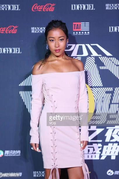 Singer Jike Junyi arrives at the red carpet of L'Officiel Fashion Night 2017 on November 29 2017 in Beijing China