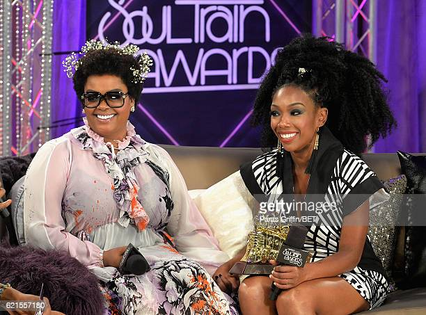 Singer Jill Scott and Lady of Soul Award honoree Brandy are interviewed backstage during the 2016 Soul Train Music Awards at the Orleans Arena on...