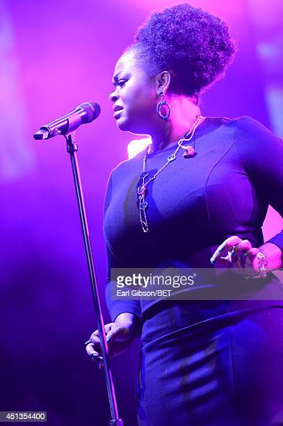 Singer Jill Scott performs onstage at the Maxwell Jill Scott Marsha Ambrosius and Candice Glover concert during the 2014 BET Experience At LA LIVE at...