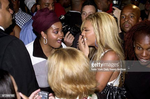 Singer Jill Scott yells 'Surprise' as Beyonce Knowles of Destiny's Child arrives at the birthday party thrown for her by MTV at Club One51 in...
