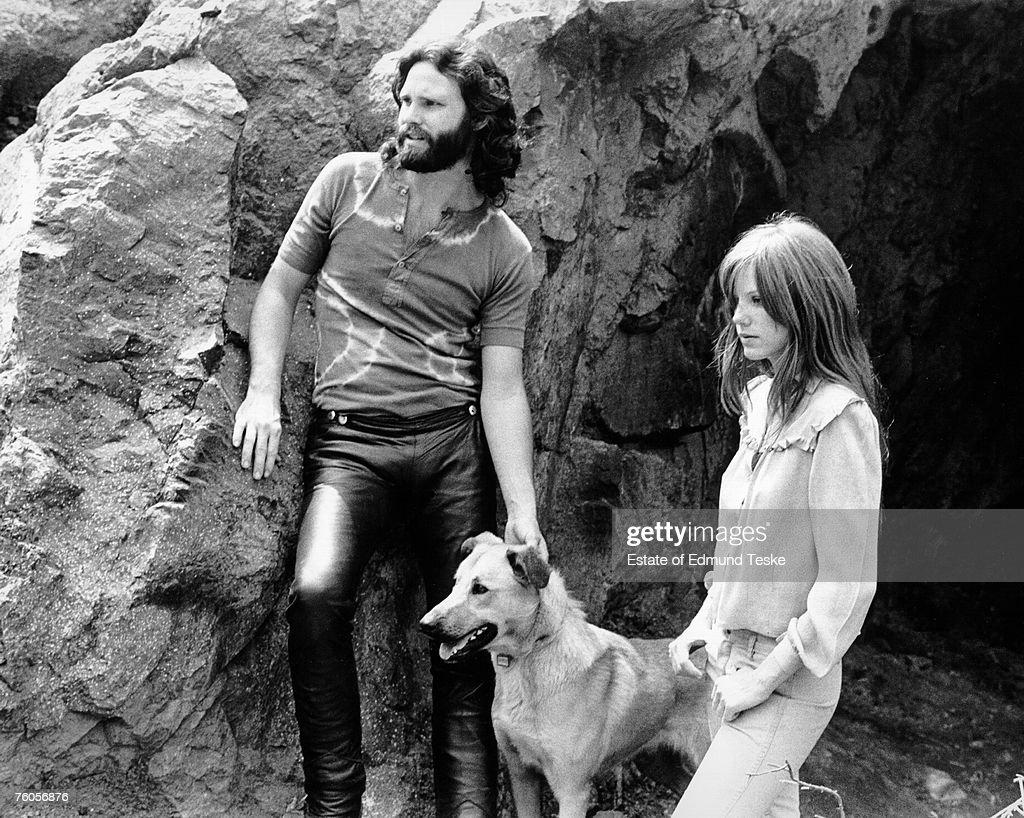 Singer Jim Morrison of The Doors with girlfriend Pamela Courson during a 1969 photo shoot at Bronson Caves in the Hollywood Hills, California.