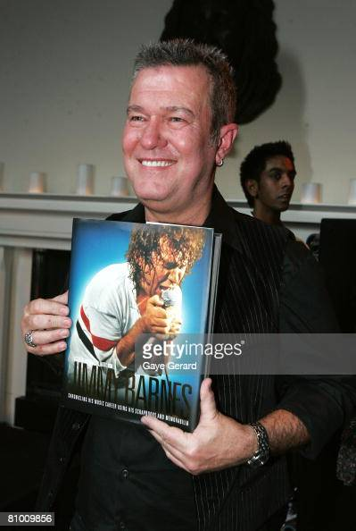 Singer Jimmy Barnes poses with his new book during the launch of his biography at the Hilton Hotel on May 7 2008 in Sydney Australia