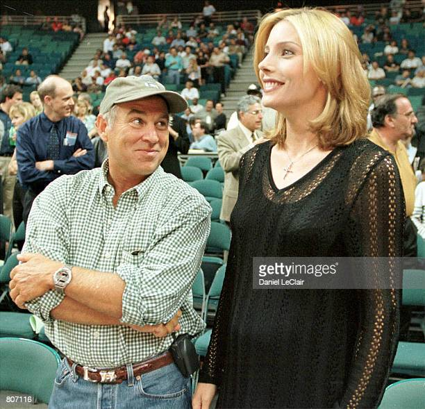 Singer Jimmy Buffett talks to Sylvester Stallone's wife Jennifer Flavin before game one of the NBA playoffs at the Miami Arena as the New York Knicks...