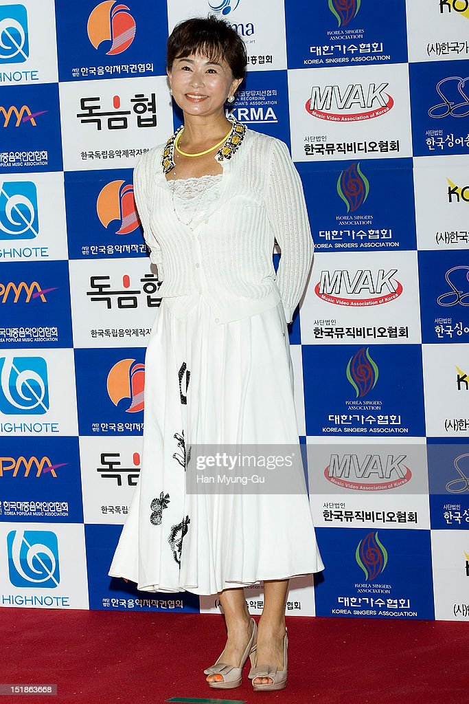 Singer Jin Mi-Ryeong arrives the launch event of 'Popular Music Promotion Committee' on September 12, 2012 in Seoul, South Korea.