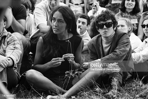 Singer Joan Baez and singer songwriter Donovan backstage at the Newport Folk Festival in July 1965 in Newport Rhode Island