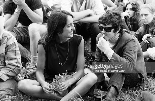 Singer Joan Baez and singer/songwriter Donovan backstage at the Newport Folk Festival in July 1965 in Newport Rhode Island