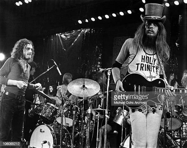 Singer Joe Cocker performs onstage at the Fillmore East for his 'Mad Dogs And Englishmen' live album with musician Leon Russell wearing a top hat and...
