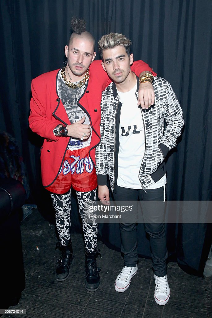 Singer <a gi-track='captionPersonalityLinkClicked' href=/galleries/search?phrase=Joe+Jonas&family=editorial&specificpeople=842712 ng-click='$event.stopPropagation()'>Joe Jonas</a> (R) and guest attend ESPN The Party on February 6, 2016 in San Francisco, California.