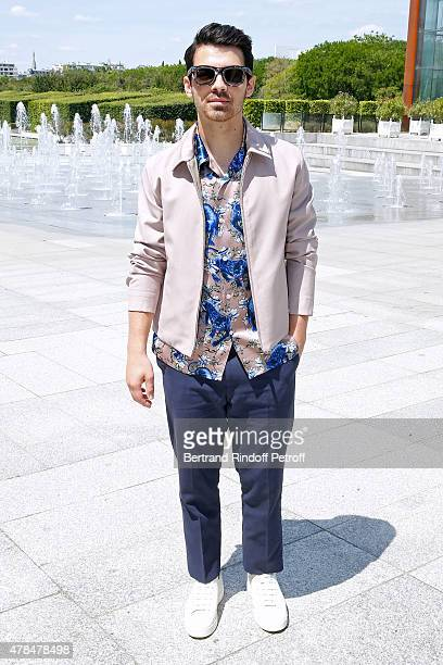Singer Joe Jonas attends the Louis Vuitton Menswear Spring/Summer 2016 show as part of Paris Fashion Week on June 25 2015 in Paris France
