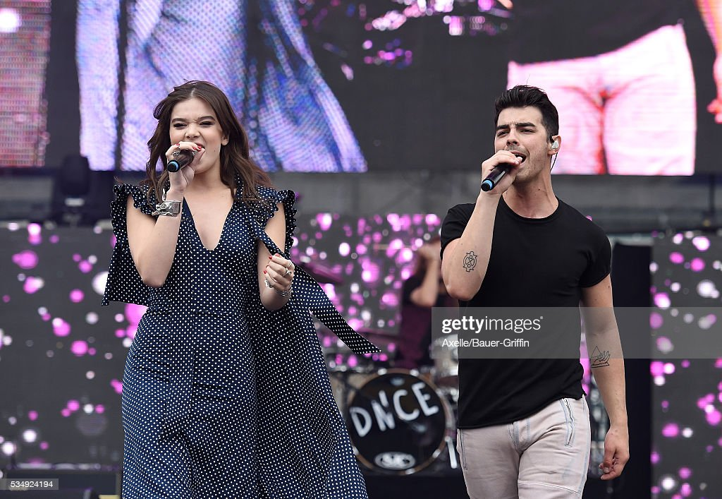 Singer Joe Jonas of DNCE and actress/singer Hailee Steinfeld perform at 1027 KIIS FM's Wango Tango 2016 at StubHub Center on May 14 2016 in Carson...