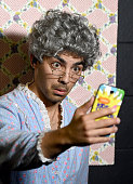 Singer Joe Jonas takes a selfie during Nickelodeon's 28th Annual Kids' Choice Awards held at The Forum on March 28 2015 in Inglewood California
