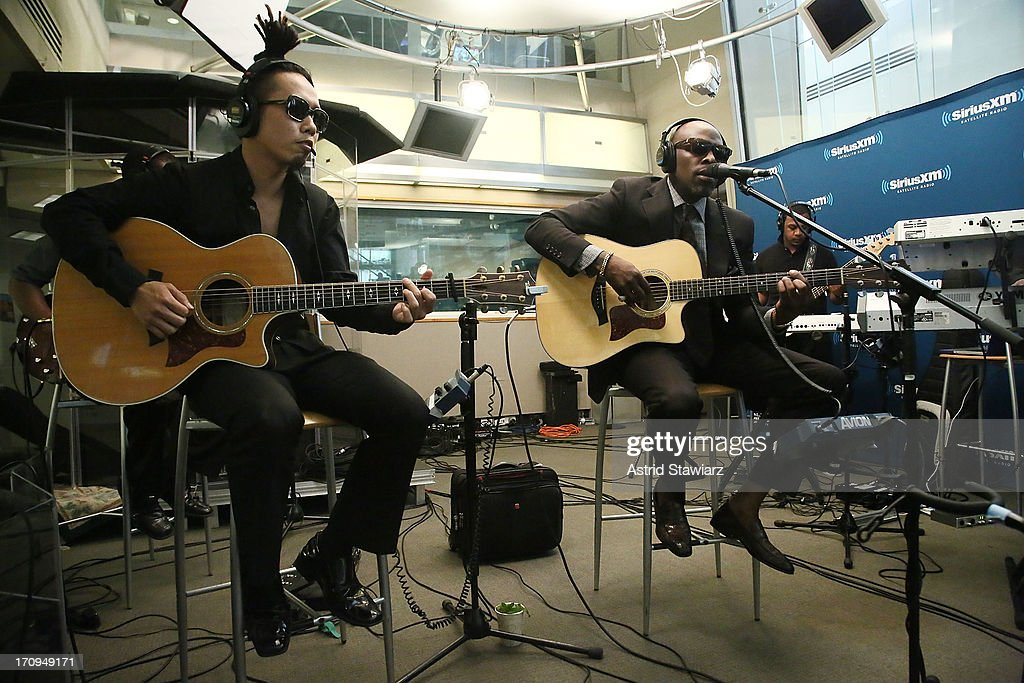 Singer Joe (R) performs live on Heart & Soul's 'Up Close & Personal' at SiriusXM Studios on June 20, 2013 in New York City.