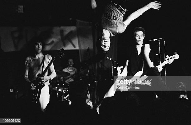Singer Joe Strummer hanging from the rafters during a performance by English punk group The Clash at Rafters Manchester 3rd July 1978 Left to right...