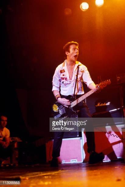 Singer Joe Strummer performing with English punk group The Clash circa 1979