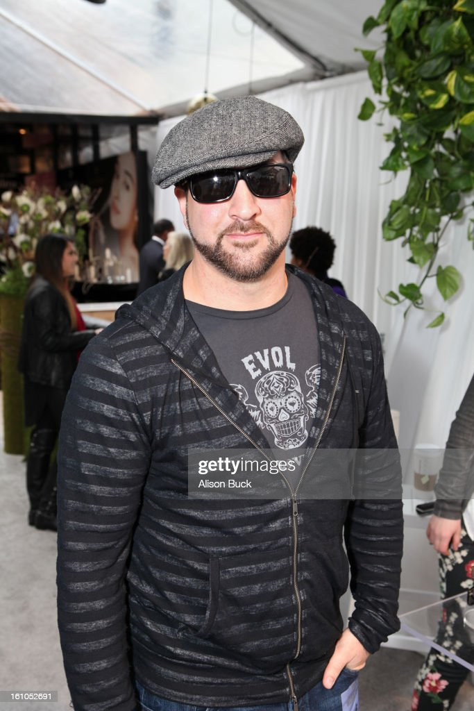 Singer Joey Fatone in Polarioid X 8300/S poses with SOLSTICE Sunglasses and Safilo USA during the 55th Annual GRAMMY Awards on February 8, 2013 in Los Angeles, California.