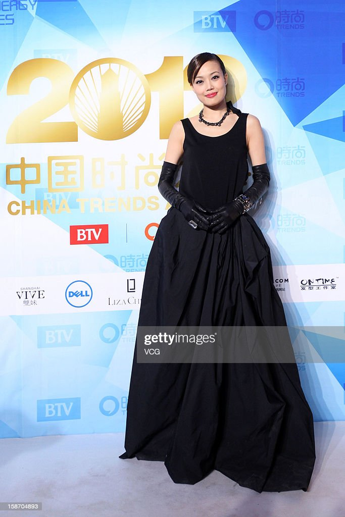 Singer <a gi-track='captionPersonalityLinkClicked' href=/galleries/search?phrase=Joey+Yung&family=editorial&specificpeople=798867 ng-click='$event.stopPropagation()'>Joey Yung</a> arrives at the red carpet of the 2012 China Trends Awards at BTV Grand Theater on December 22, 2012 in Beijing, China.