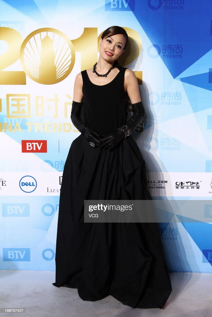 Singer Joey Yung arrives at the red carpet of the 2012 China Trends Awards at BTV Grand Theater on December 22, 2012 in Beijing, China.