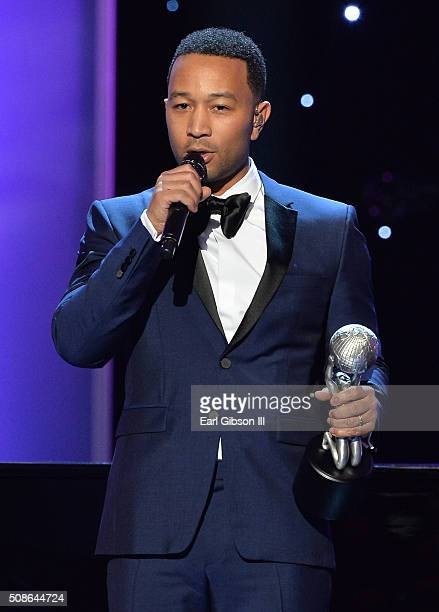 Singer John Legend accepts the President's Award onstage during the 47th NAACP Image Awards presented by TV One at Pasadena Civic Auditorium on...