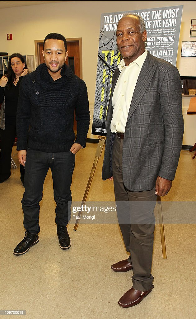 Singer John Legend (L) and actor Danny Glover attend 'The House I Live In' Washington DC Screening And Performance By John Legend at Shiloh Baptist Church on January 19, 2013 in Washington, DC.
