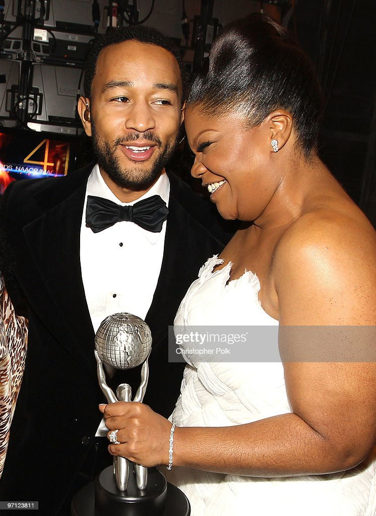 Singer <a gi-track='captionPersonalityLinkClicked' href=/galleries/search?phrase=John+Legend&family=editorial&specificpeople=201468 ng-click='$event.stopPropagation()'>John Legend</a> (L) and actress <a gi-track='captionPersonalityLinkClicked' href=/galleries/search?phrase=Mo%27Nique&family=editorial&specificpeople=213364 ng-click='$event.stopPropagation()'>Mo'Nique</a> poss with her award for Outstanding Supporting Actress in a Motion Picture backstage during the 41st NAACP Image awards held at The Shrine Auditorium on February 26, 2010 in Los Angeles, California.