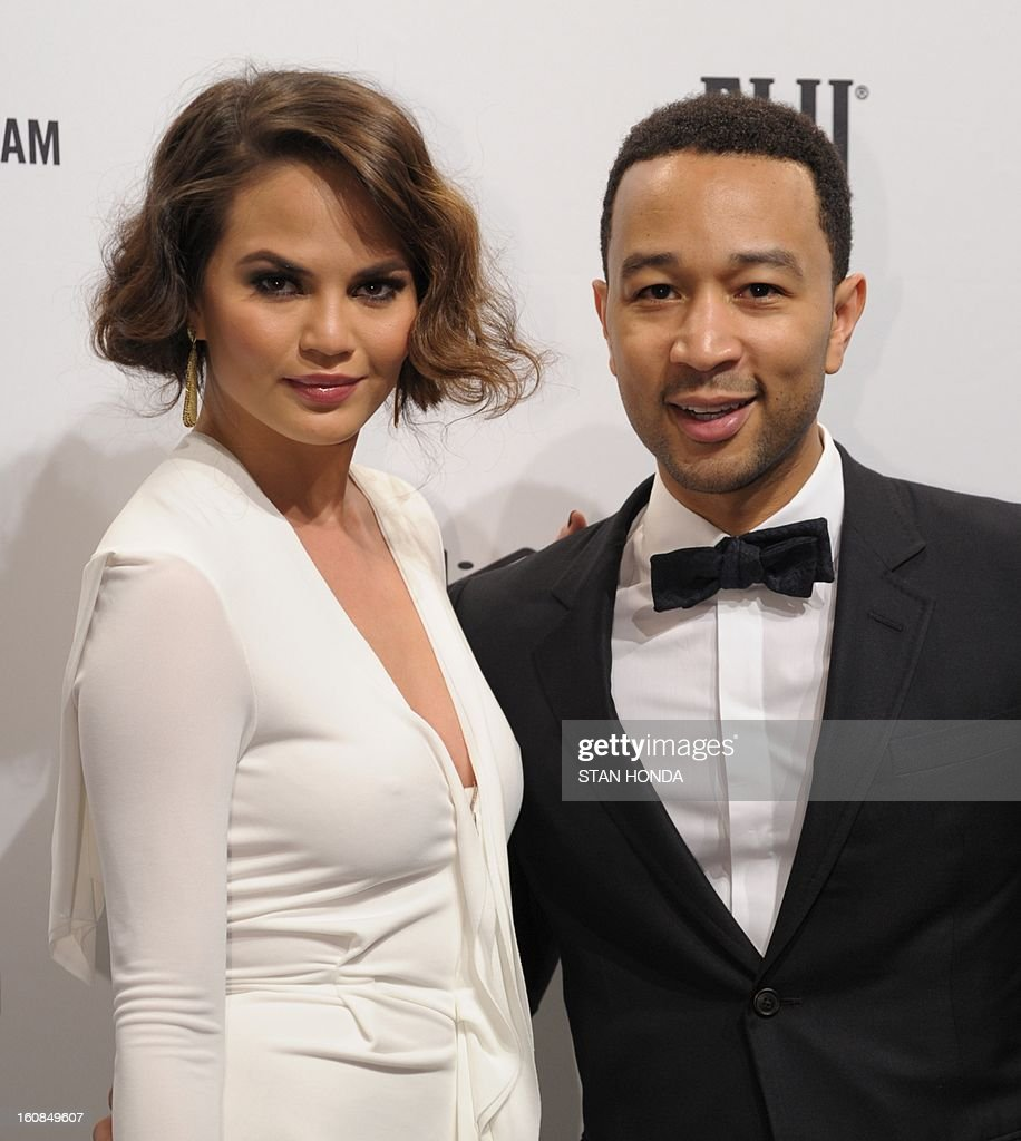Singer John Legend (R) and Chrissy Teigen (L) arrive at the amfAR (The Foundation for AIDS Research) gala that kicks off the Mercedes-Benz Fashion Week February 6, 2013 in New York. AFP PHOTO/Stan HONDA