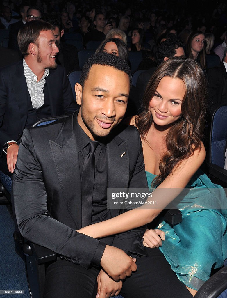 Singer <a gi-track='captionPersonalityLinkClicked' href=/galleries/search?phrase=John+Legend&family=editorial&specificpeople=201468 ng-click='$event.stopPropagation()'>John Legend</a> (L) and <a gi-track='captionPersonalityLinkClicked' href=/galleries/search?phrase=Christine+Teigen&family=editorial&specificpeople=4583768 ng-click='$event.stopPropagation()'>Christine Teigen</a> at the 2011 American Music Awards held at Nokia Theatre L.A. LIVE on November 20, 2011 in Los Angeles, California.