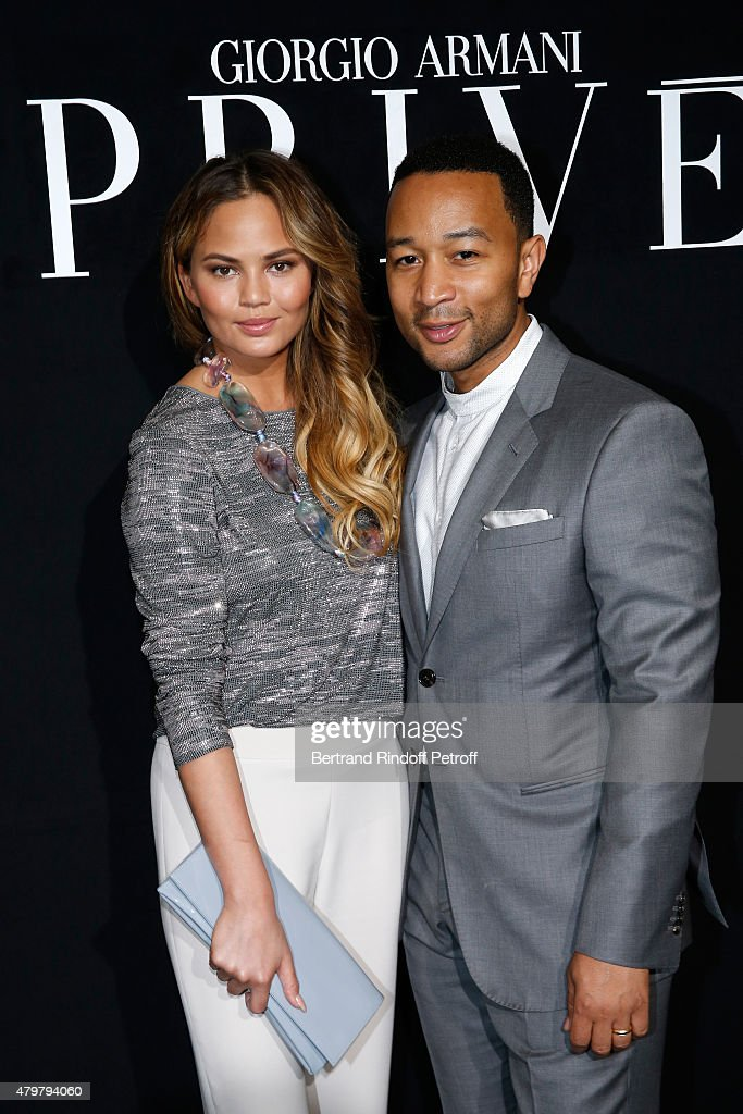 Singer <a gi-track='captionPersonalityLinkClicked' href=/galleries/search?phrase=John+Legend&family=editorial&specificpeople=201468 ng-click='$event.stopPropagation()'>John Legend</a> (R) and his wife Model Chrissy Teigen (L) attend the Giorgio Armani Prive show as part of Paris Fashion Week Haute-Couture Fall/Winter 2015/2016. Held at Palais de Chaillot on July 7, 2015 in Paris, France.
