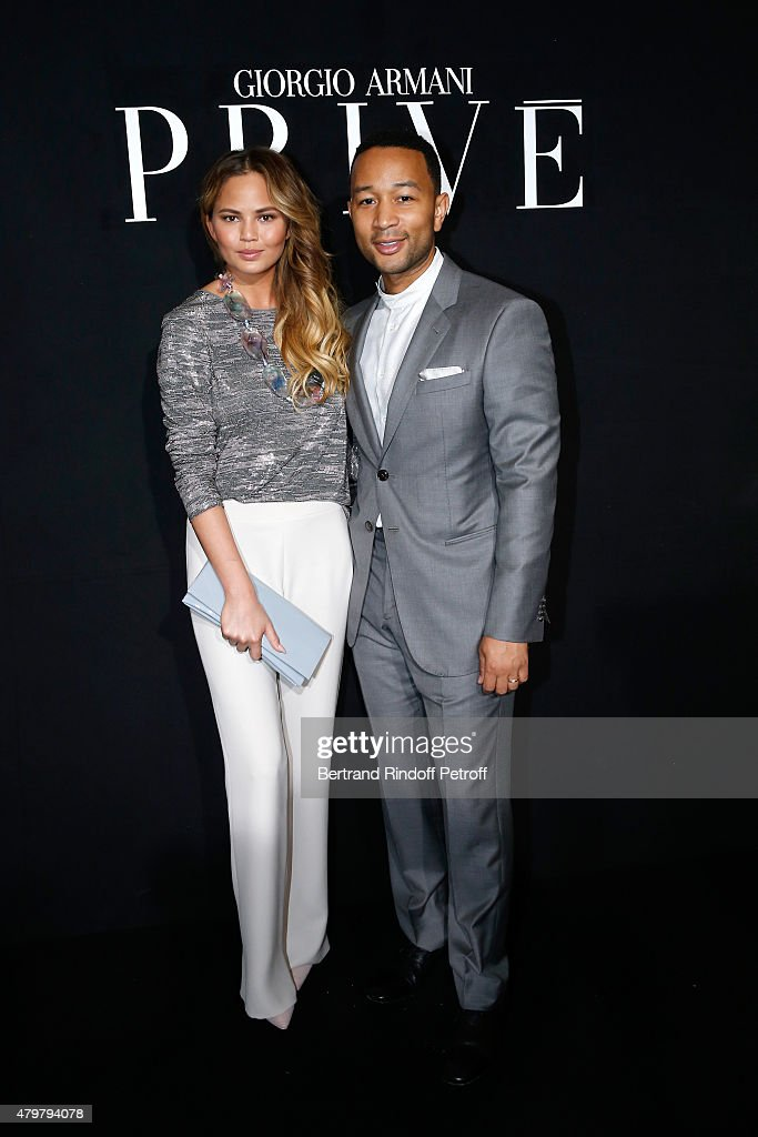 Singer John Legend and his wife Model Chrissy Teigen attend the Giorgio Armani Prive show as part of Paris Fashion Week HauteCouture Fall/Winter...