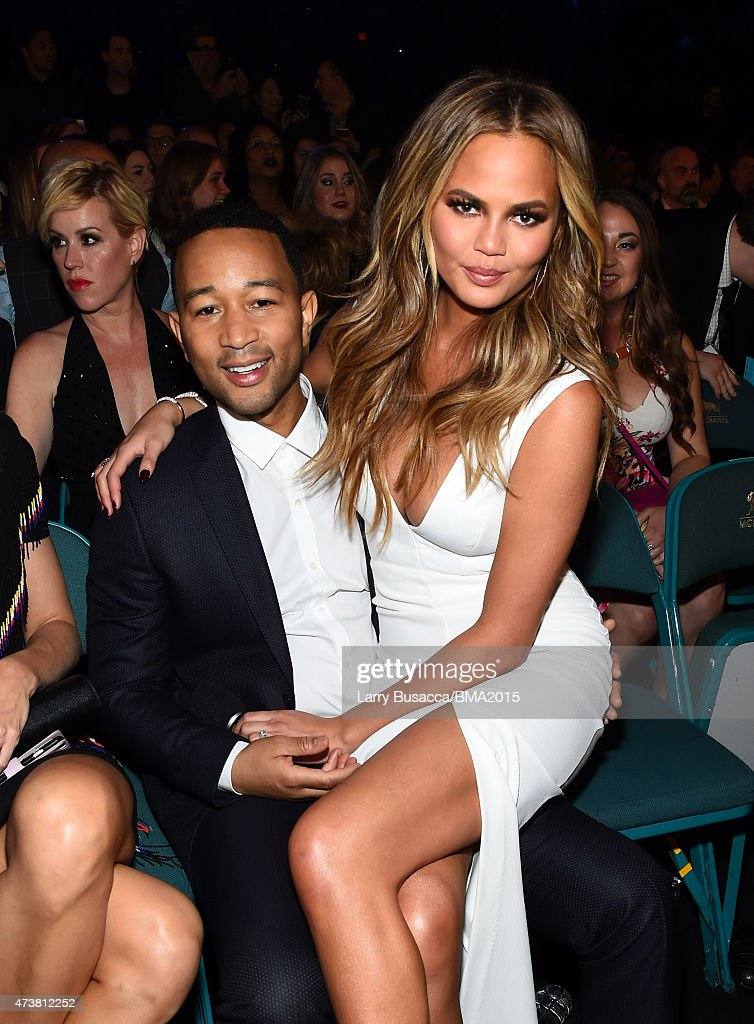 Singer John Legend (L) and host Chrissy Teigen attend the 2015 Billboard Music Awards at MGM Grand Garden Arena on May 17, 2015 in Las Vegas, Nevada.
