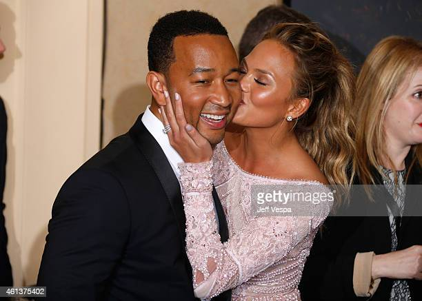 Singer John Legend and mocel Chrissy Teigen pose in the press room during the 72nd Annual Golden Globe Awards at The Beverly Hilton Hotel on January...