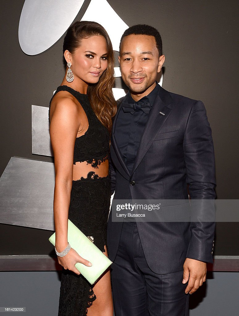 Singer John Legend (R) and model Chrissy Teigen attend the 55th Annual GRAMMY Awards at STAPLES Center on February 10, 2013 in Los Angeles, California.