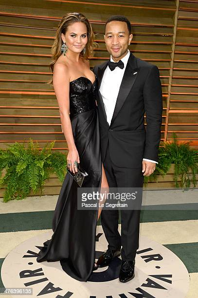 Singer John Legend and model Chrissy Teigen attends the 2014 Vanity Fair Oscar Party hosted by Graydon Carter on March 2 2014 in West Hollywood...