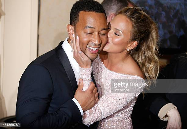 Singer John Legend and model Chrissy Teigen pose in the press room during the 72nd Annual Golden Globe Awards at The Beverly Hilton Hotel on January...