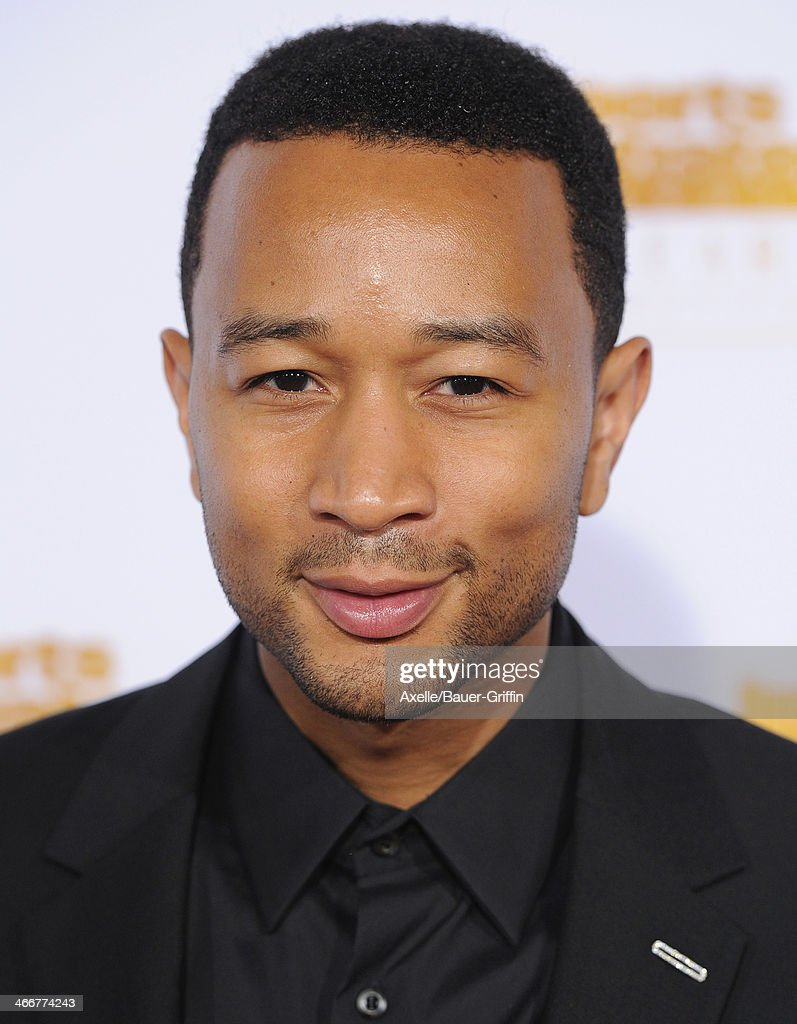 Singer <a gi-track='captionPersonalityLinkClicked' href=/galleries/search?phrase=John+Legend&family=editorial&specificpeople=201468 ng-click='$event.stopPropagation()'>John Legend</a> arrives at NBC And Time Inc. Celebrate 50th Anniversary Of Sports Illustrated Swimsuit Issue at Dolby Theatre on January 14, 2014 in Hollywood, California.