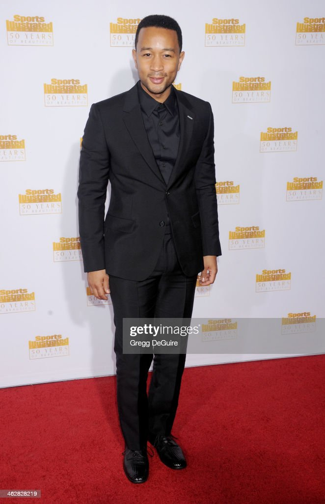 Singer John Legend arrives at the 50th Anniversary Celebration Of Sports Illustrated Swimsuit Issue at Dolby Theatre on January 14, 2014 in Hollywood, California.
