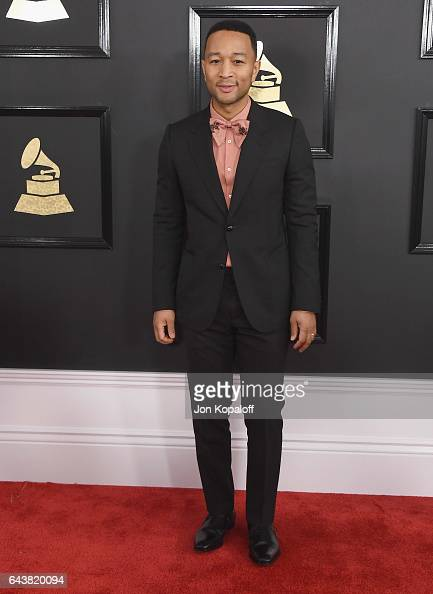 Singer John Legend arrives at the 59th GRAMMY Awards at the Staples Center on February 12 2017 in Los Angeles California