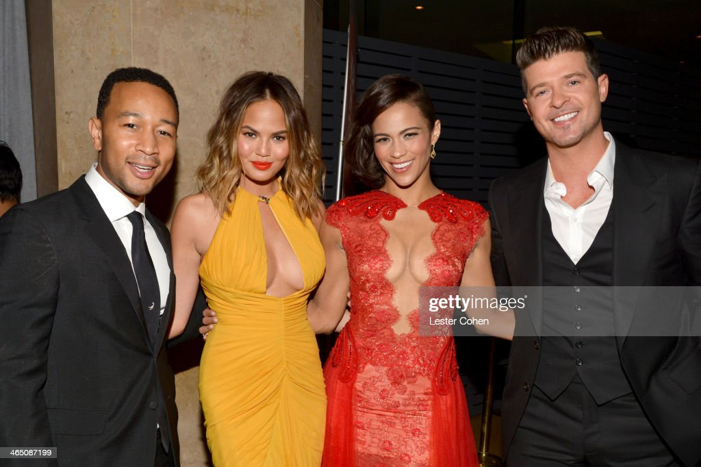 Singer <a gi-track='captionPersonalityLinkClicked' href=/galleries/search?phrase=John+Legend&family=editorial&specificpeople=201468 ng-click='$event.stopPropagation()'>John Legend</a>, model <a gi-track='captionPersonalityLinkClicked' href=/galleries/search?phrase=Christine+Teigen&family=editorial&specificpeople=4583768 ng-click='$event.stopPropagation()'>Christine Teigen</a>, actress <a gi-track='captionPersonalityLinkClicked' href=/galleries/search?phrase=Paula+Patton&family=editorial&specificpeople=752812 ng-click='$event.stopPropagation()'>Paula Patton</a>, and singer <a gi-track='captionPersonalityLinkClicked' href=/galleries/search?phrase=Robin+Thicke&family=editorial&specificpeople=724390 ng-click='$event.stopPropagation()'>Robin Thicke</a> attend the 56th annual GRAMMY Awards Pre-GRAMMY Gala and Salute to Industry Icons honoring Lucian Grainge at The Beverly Hilton on January 25, 2014 in Los Angeles, California.