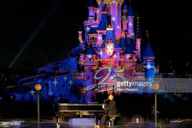 Singer John Legend performs during the Disneyland Paris 25th Anniversary at Disneyland Paris on March 25 2017 in Paris France