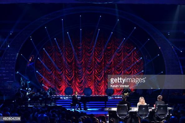 Singer John Legend performs onstage during Fox's 'American Idol' XIII Finale at Nokia Theatre LA Live on May 21 2014 in Los Angeles California