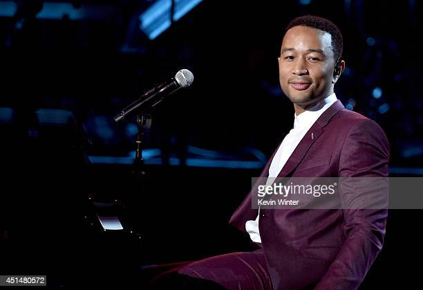 Singer John Legend performs onstage during the BET AWARDS '14 at Nokia Theatre LA LIVE on June 29 2014 in Los Angeles California