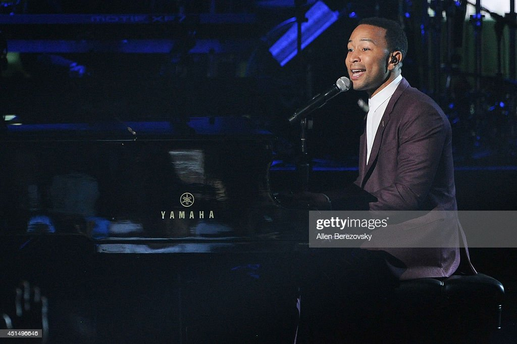 Singer <a gi-track='captionPersonalityLinkClicked' href=/galleries/search?phrase=John+Legend&family=editorial&specificpeople=201468 ng-click='$event.stopPropagation()'>John Legend</a> performs onstage during the BET Awards '14 at Nokia Theatre L.A. Live on June 29, 2014 in Los Angeles, California.