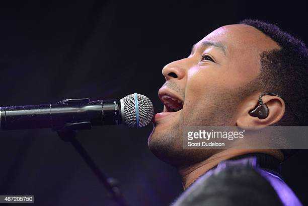 Singer John Legend performs onstage during the SPIN/AXE White Label Collective SXSW party at Cheer Up Charlie's on March 21 2015 in Austin Texas