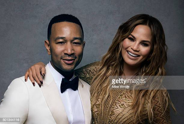 Singer John Legend poses with wife and model Chrissy Teigen for a portrait at the Sinatra 100 An AllStar GRAMMY Concert at Wynn Las Vegas on December...