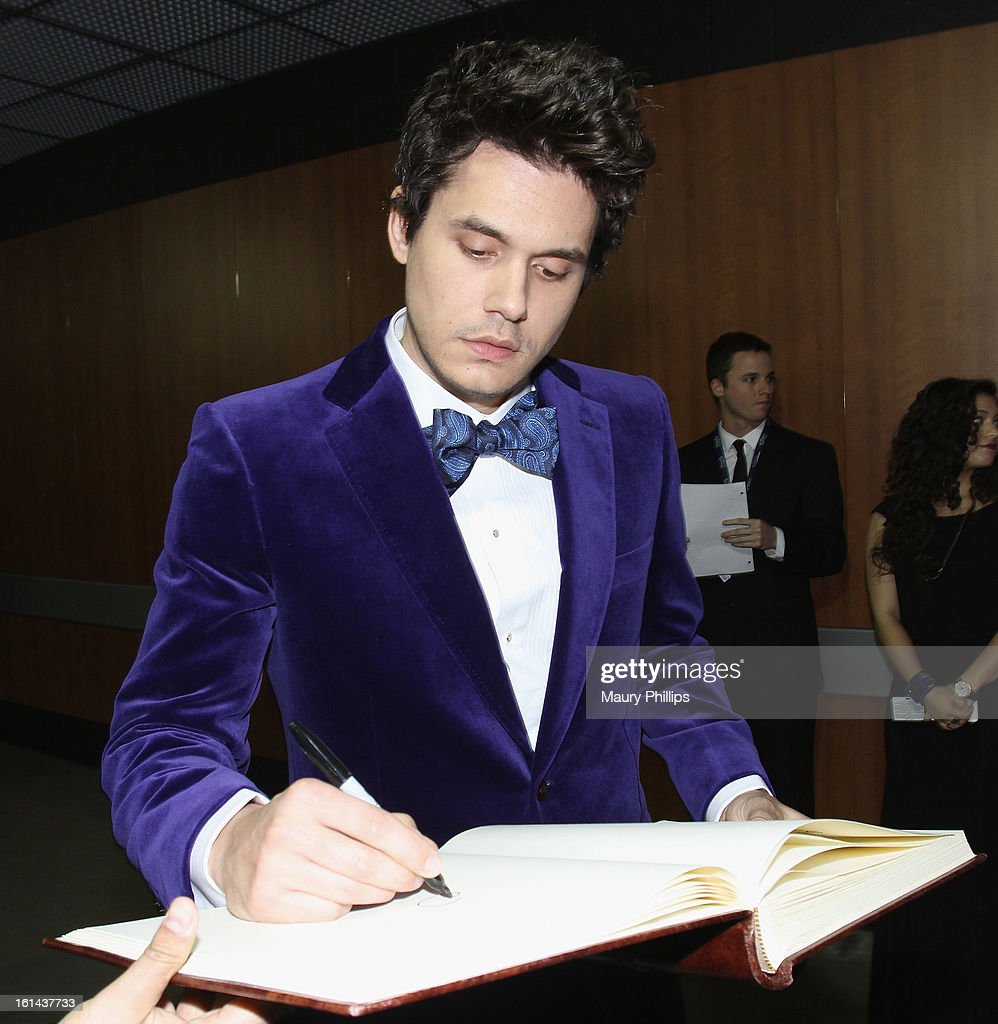 Singer <a gi-track='captionPersonalityLinkClicked' href=/galleries/search?phrase=John+Mayer&family=editorial&specificpeople=201930 ng-click='$event.stopPropagation()'>John Mayer</a> poses at the GRAMMY Charities Signing Booth during the 55th Annual GRAMMY Awards at STAPLES Center on February 10, 2013 in Los Angeles, California.